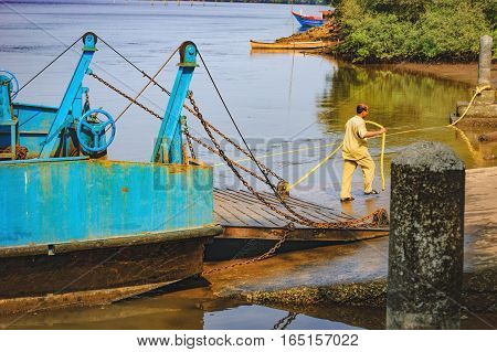 Goa, India - November 13, 2012: Ferry was moored to the shore. Ferry arriving to Chorao island Goa India. Ferries is only means of transport across many rivers of India as there is no bridge