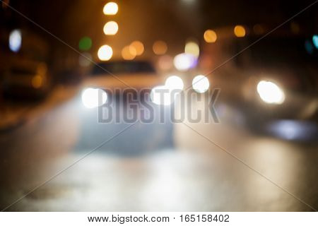 blurred car on a city street in the night. background