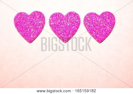 Sparkle, twinkle and glittering pink hearts.  Valentine's day, wedding, anniversary, romantic symbol of love.