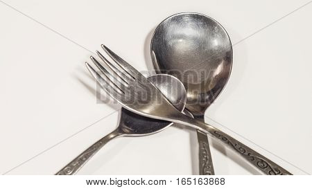 Two spoons and fork on a isolated white background