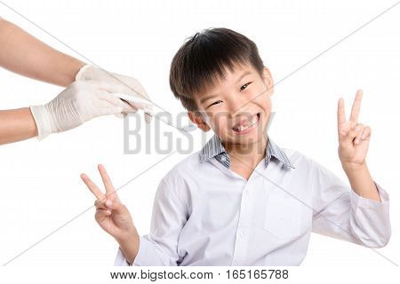 Dentist Checking Young Asian Boy Teeth