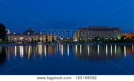 United States Botanic Garden in Washington DC. Night view of the US Botanic Garden across the Capitol Reflecting Pool with beautiful reflections.