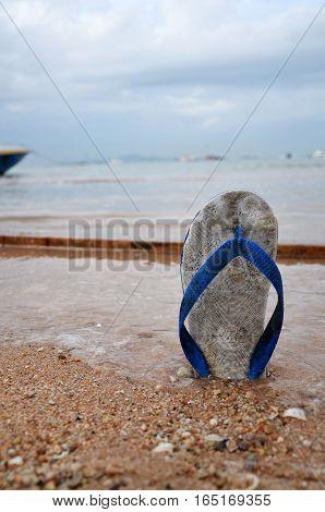 Beach slippers on a sandy beach in Pattaya Thailand
