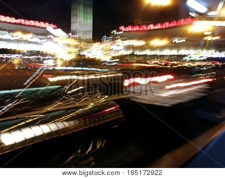 Cityscape With Road Traffic. Blurred Night Light Trails.
