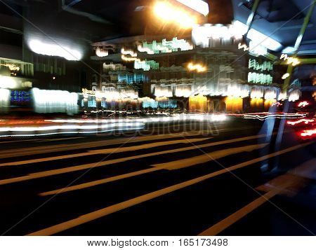 Car Traffic At Night. Motion Blur Background.