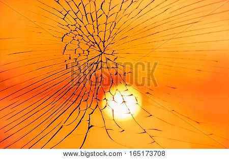 Fractured Mirror on blurred reflection of sunset sky background