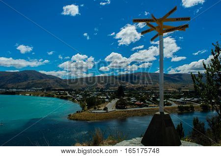 Landscape view of a signpost to paradise
