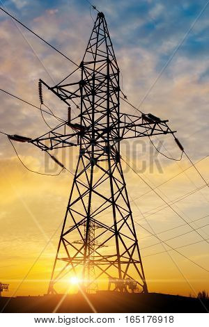 Wire electrical energy at sunset and the sun's rays