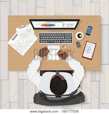 Business workplace. Top view of businessman working on laptop in the office. Businessman top concept