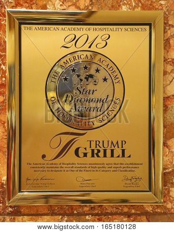 NEW YORK- DECEMBER 15, 2016: A plaque awarding the Trump Grill five stars by the American Academy of Hospitality Sciences displayed in the Trump Tower in New York