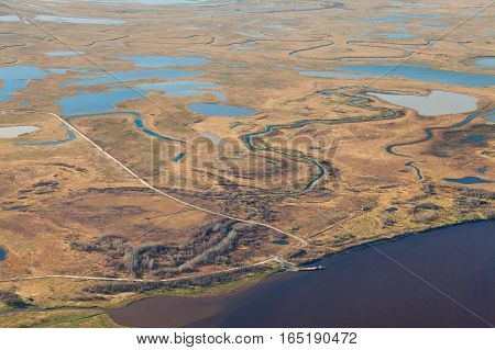 ferryboat at the bank of river in autumn top view