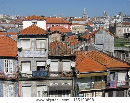 Houses roof in historic part of second largest city of PORTO, OPORTO in PORTUGAL with clear blue sky in warm day, EUROPE, OCTOBER.