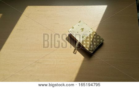 Fabric card holder under the afternoon Sun light.