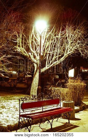 beautiful night landscape city bench under a lamp