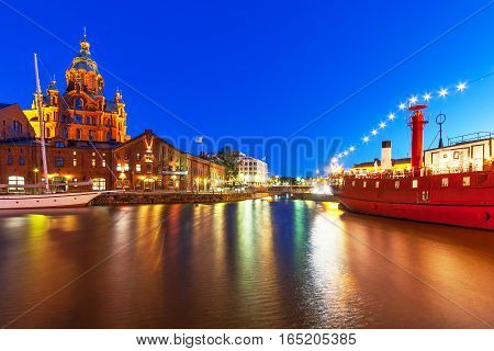 Scenic night panorama of the Uspenski Orthodox Cathedral Church pier architecture in Katajanokka District in the Old Town of Helsinki, Finland