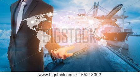 Global network coverage world map on hand of businessman Industrial Container Cargo freight ship at habor for Logistic Import Export background (Elements of this image furnished by NASA)