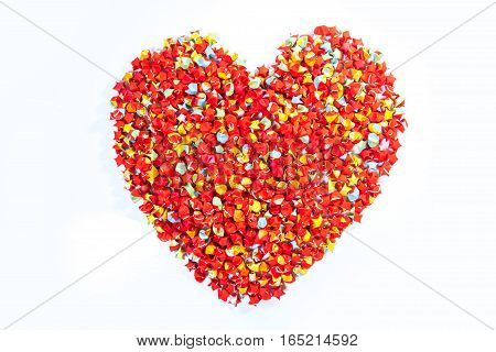 red star paper heart shape on white background
