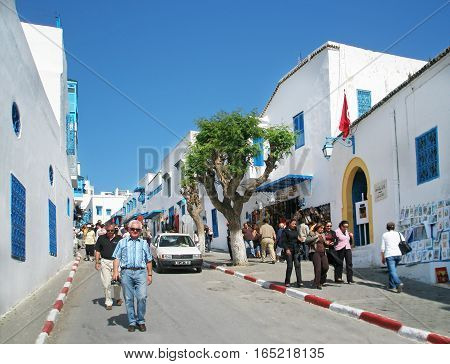 Sidi Bou Said, Tunisia - September 13, 2008: The blue and white village of Sidi Bou Said has long been a bohemian sanctuary- and its beauty now attracts wealthy Tunisians and inquisitive tourists alike