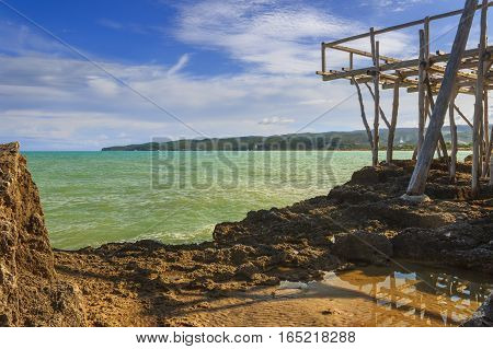 Gargano coast:bay of Vieste.Apulia, ITALY. View from a trebuchet abandoned.A trabucco is an old fishing machine built,which consists of a platform anchored to the rock by large logs of pine of Aleppo