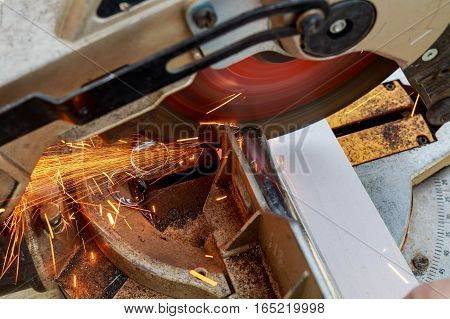 Industrial Engineer Working On Cutting A Metal And Steel With Compound Mitre Saw  Sharp, Circular Bl