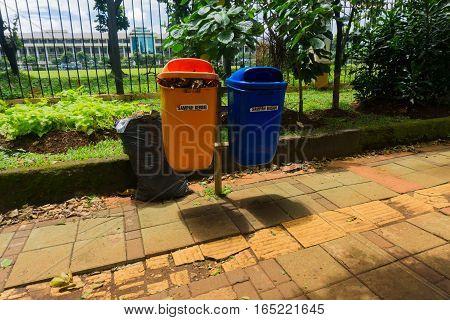 Organic and unorganic trash bin in pedestrian photo taken in Jakarta Indonesia java