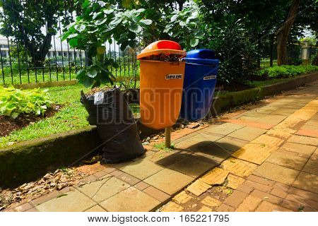orange and blue trash bin photo taken in Jakarta Indonesia java
