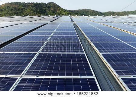 Solar PV Rooftop System with Green Mountain Background