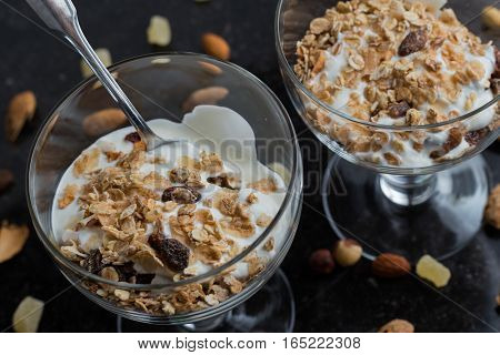 Granola With Yogurt, Nuts And Fruits In Glass Bowl On Dark Background. Delicious, Healthy Sweet Dess
