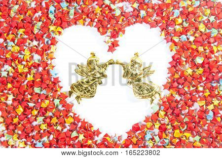red star paper heart shape on white background with angel