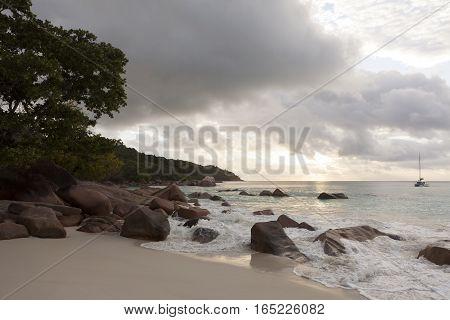 Dramatic coastline at sunset Anse Lazio Seychelles