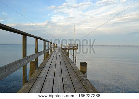 Blue Sky Summer Day by the Water. Water Bridge by Coast. Calm summer day by water.
