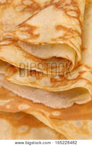 stack of folded crispy fried thin pancake closeup