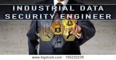 Recruitment officer in blue business suit is touching INDUSTRIAL DATA SECURITY ENGINEER on an interactive virtual computer screen. Oil and gas industry job concept for a cyber security professional.