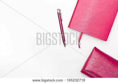 pink diary pen purse on a white background. business minimal concept for women. Flat lay top view