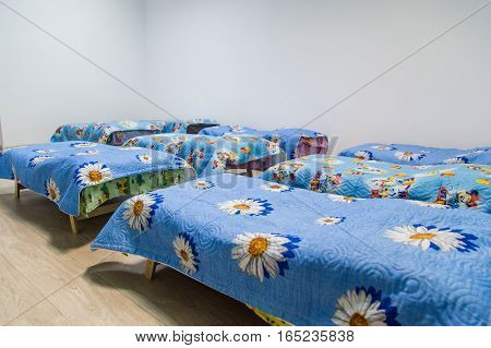 Kindergarten, bedroom with blue beds. All in focus.