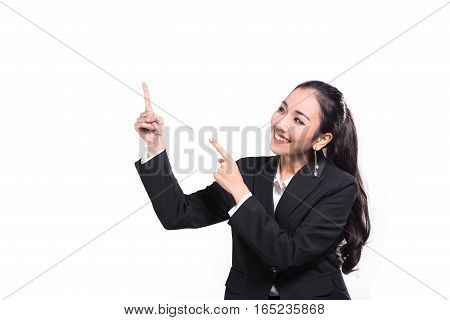 Young beautiful Asian businesswoman pointing something on white background.