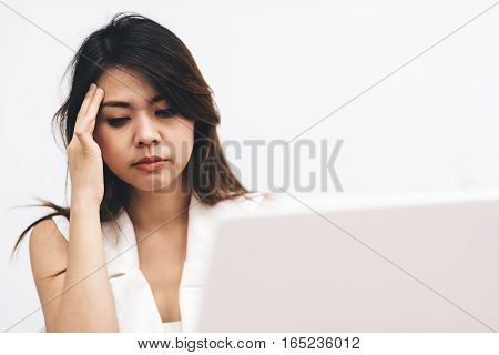 Young and beautiful Asian businesswoman tired from work. Burnout concept