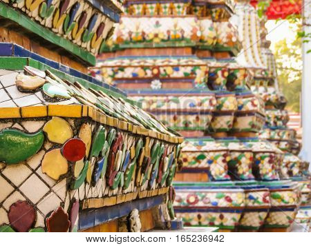 Close-up view of mosaic in the ancient Wat Arun Temple or The Temple of Dawn. Bangkok, Thailand. Selective focus