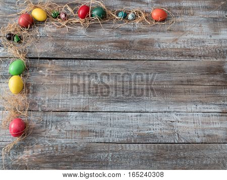 Easter Painted Eggs on wooden background.Happy Easter