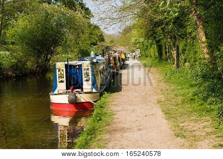 GLEDRID UNITED KINGDOM - APRIL 30 2011: Barges moored up on the Llangollen branch of the Shropshire Union canal a popular holiday getaway for families and tourists to visit and enjoy the extensive inland waterway network