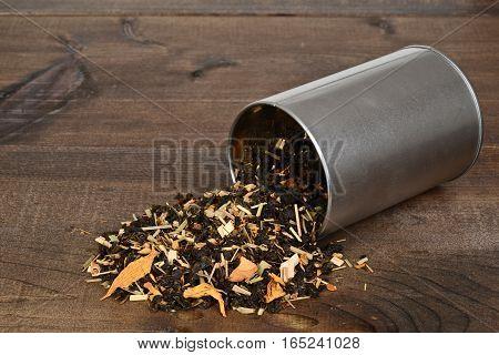 spilled organic tea with lemon grass flower petals