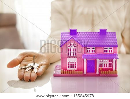 home with a key on a hand