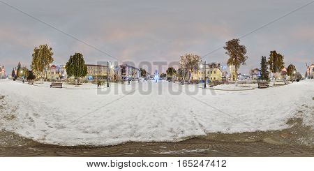TÂRGU MUREȘ, ROMANIA - December 29, 2016: Day-night composite 360 panorama of a snow-covered Piața Trandafirilor (Roses' Square), town centre of Târgu Mureș, Romania