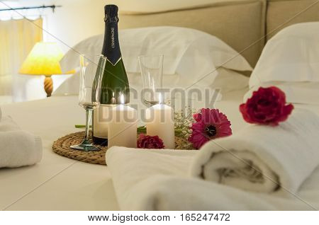 romance in bed with champagne, interior, villa