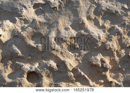 Texture background of sandstone in sunlight boulder