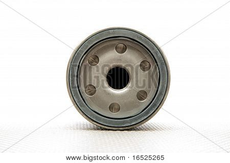 Car Oil Filter Over White Background