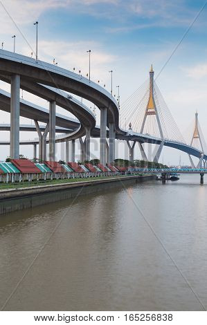 Rama9 Twin suspension bridge connect to highway intersection and bule sky background Bangkok Thailand