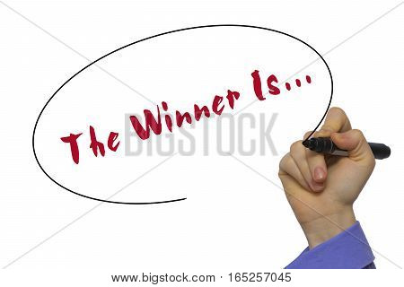 Woman Hand Writing The Winner Is... On Blank Transparent Board With A Marker Isolated Over White Bac