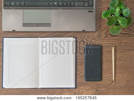 Notebook With Pen, Notebook And Flower On A Wooden Table.