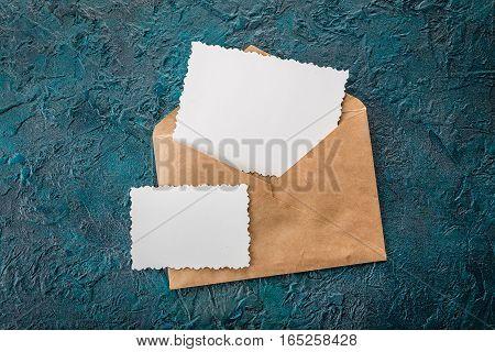Blank card and envelope on olddark background